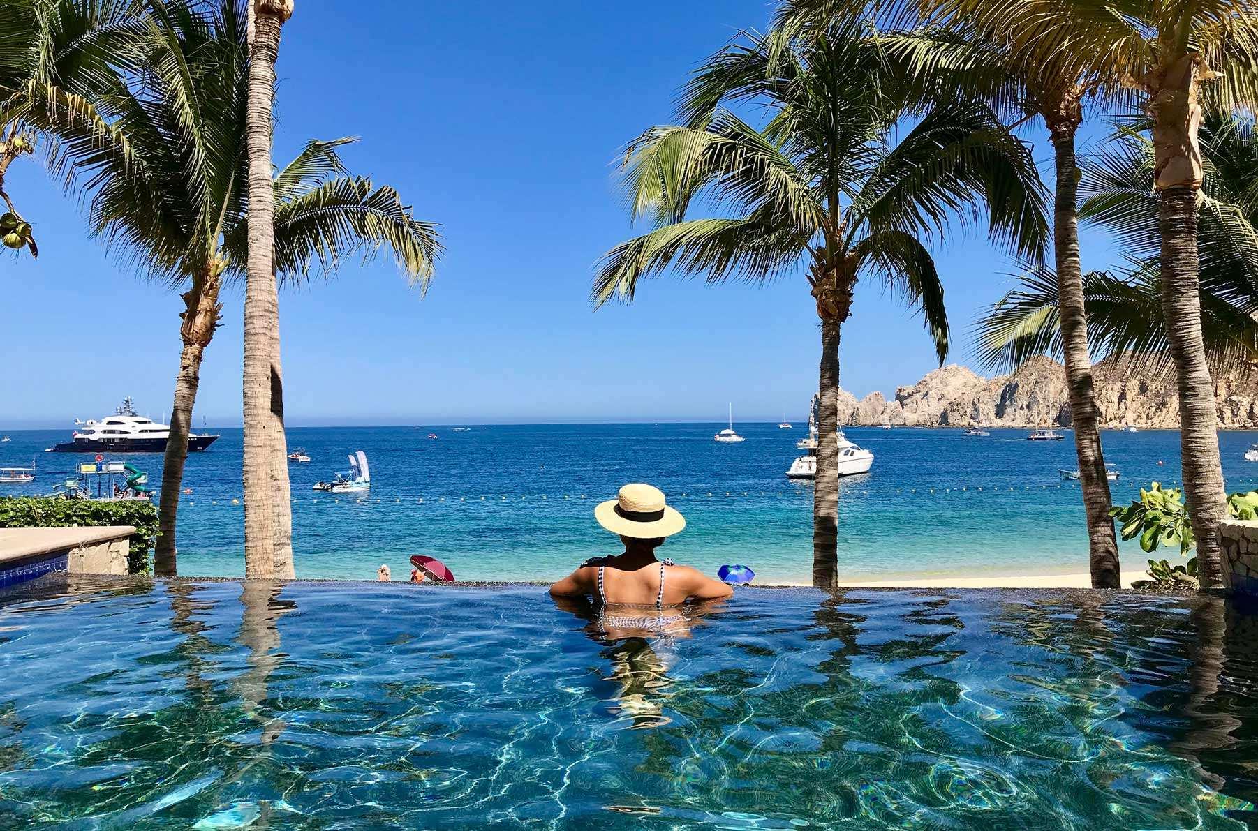 Woman in infinity pool in Los Cabos luxury rental