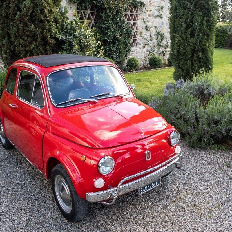 red Fiat at luxury Tuscan villa
