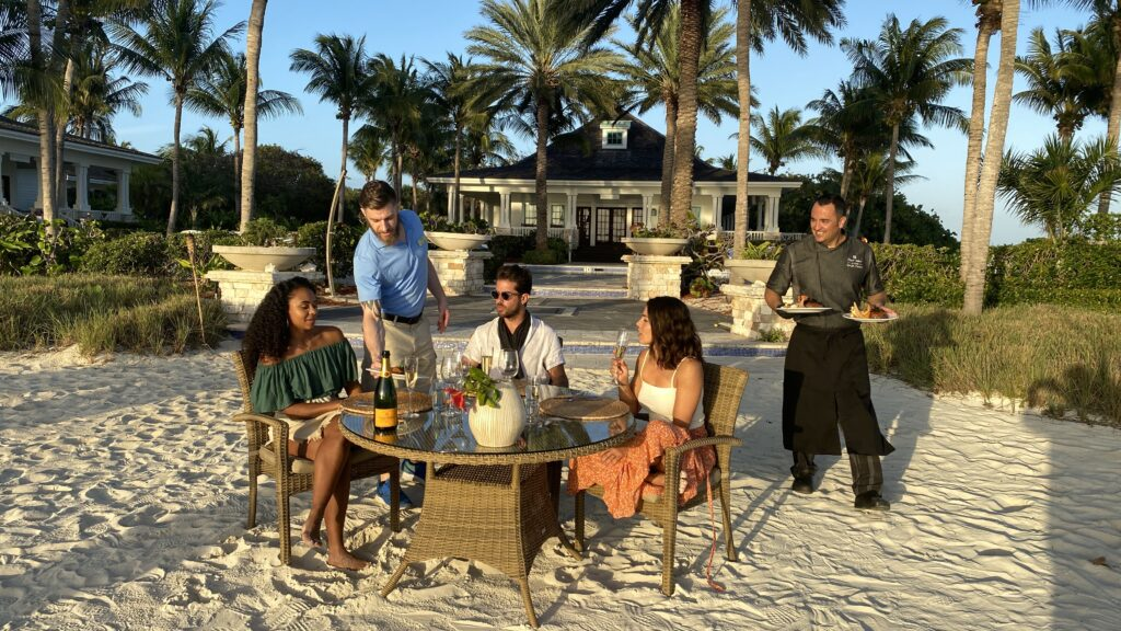 World's Most Amazing Vacation Rentals hosts eating on the beach