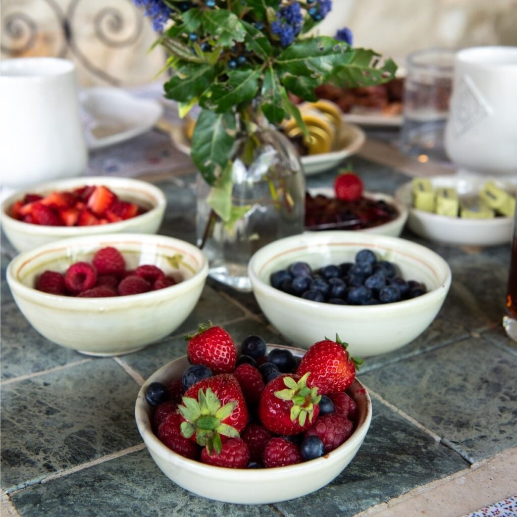 bowl of berries on breakfast table