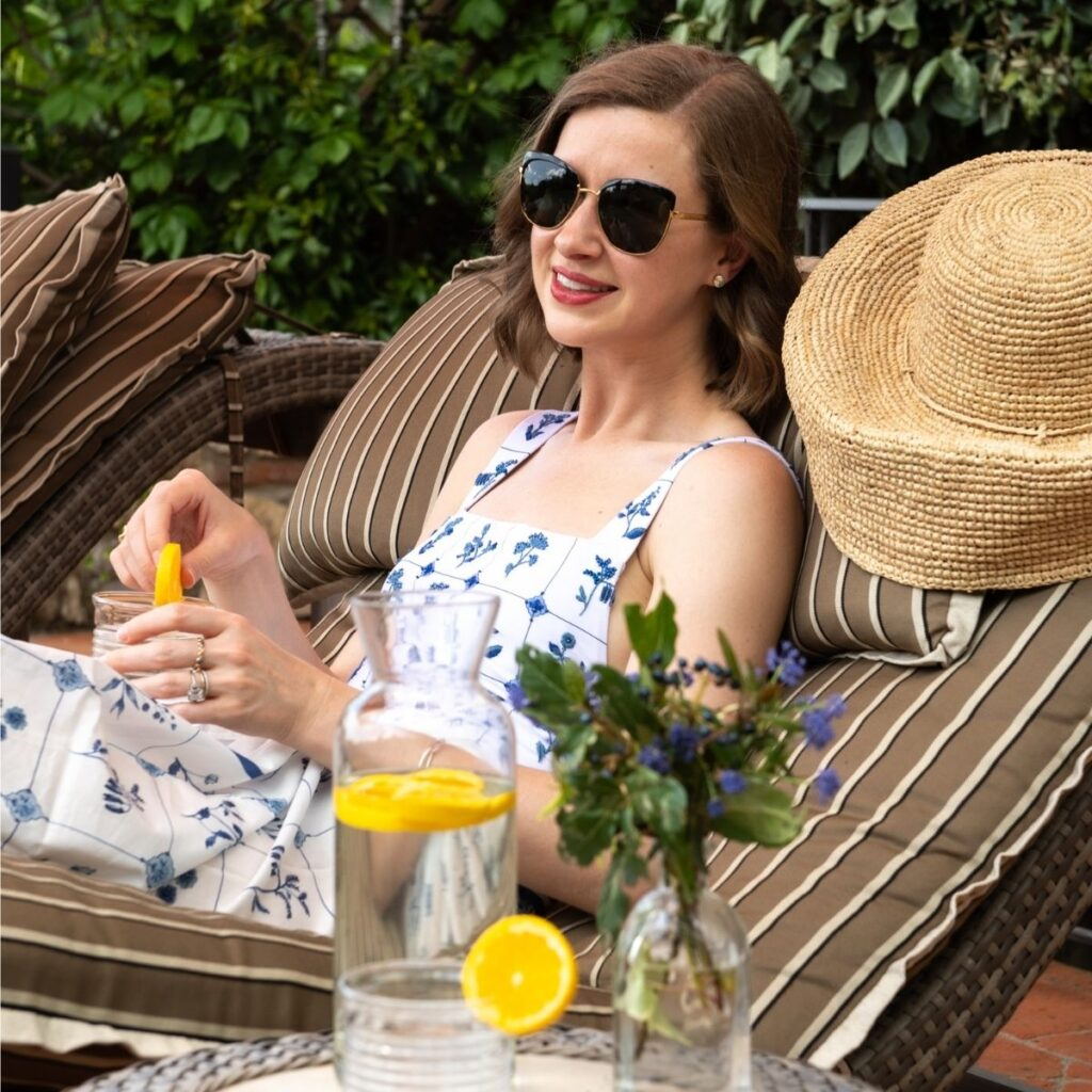 Stacie Flinner relaxing poolside on Tuscany vacation