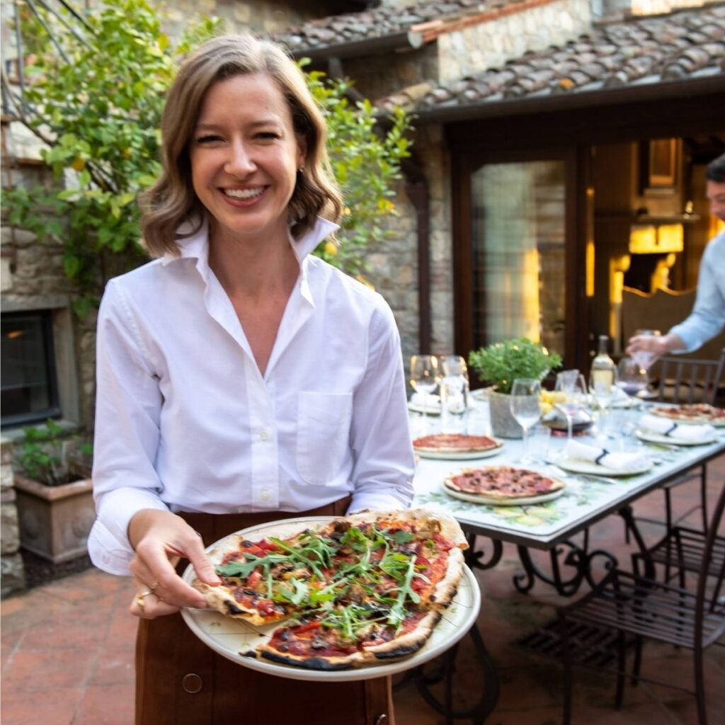 Stacie Flinner with woodfire oven pizza on tuscany vacation