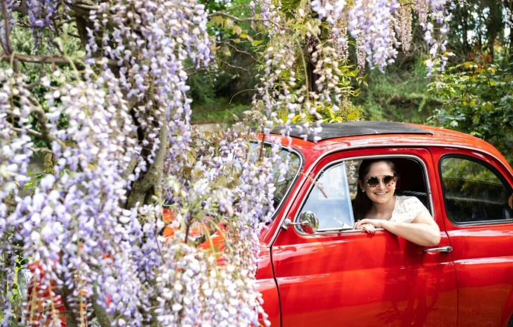 Sarah Flint in Red Fiat on Tuscan vacation